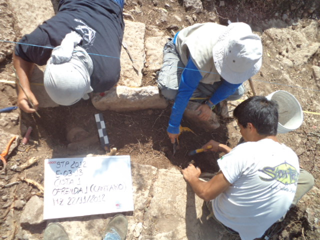 Archaeologists excavate a burial site.