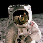An astronaut in a space suit on the moon.
