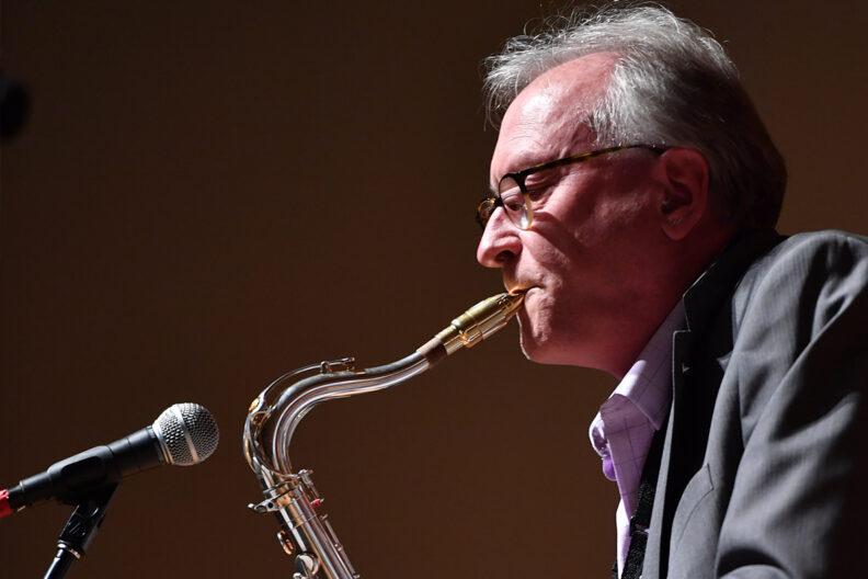Closeup of Greg Yasinitsky playing saxophone.