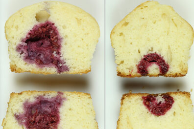 Two raspberry muffins side by side