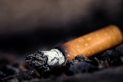 Closeup of used cigarette.