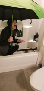 Student performs hydrology experiment in the bathtub.