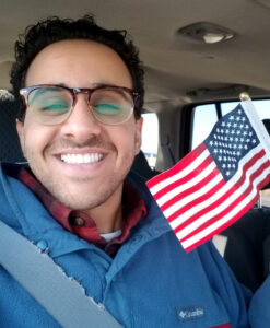 Michael Micheal holding a miniature American flag.