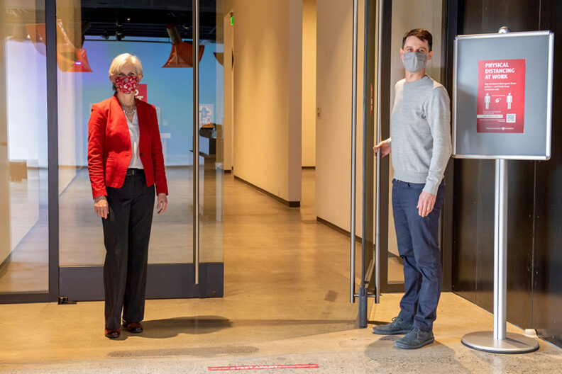 Provost Chilton and Ryan Hardesty stand beside an open door in the WSU Schnitzer Museum.