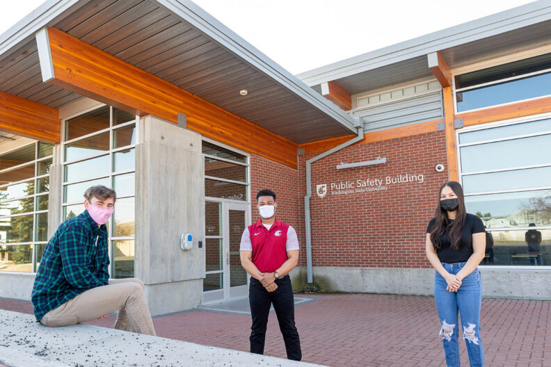 Three masked students in front of the WSU Public Safety Building.