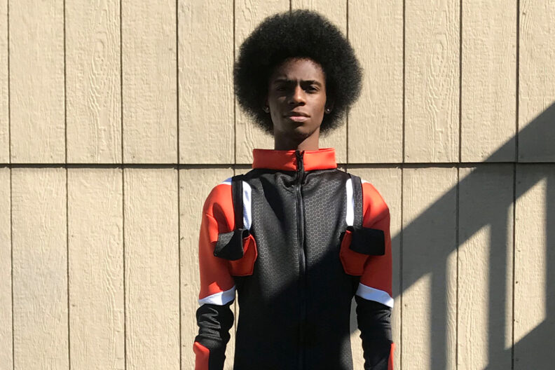 A young man models a space suit
