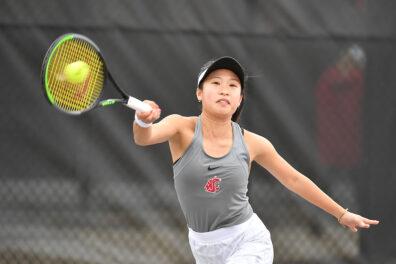 Closeup of Savanna Ly-Nguyen playing tennis.