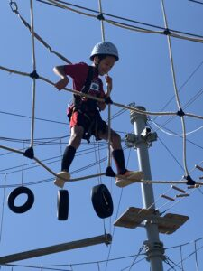 A camper takes on WSU's Challenge Course