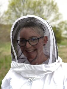 Closeup of Rae Olson in a bee suit