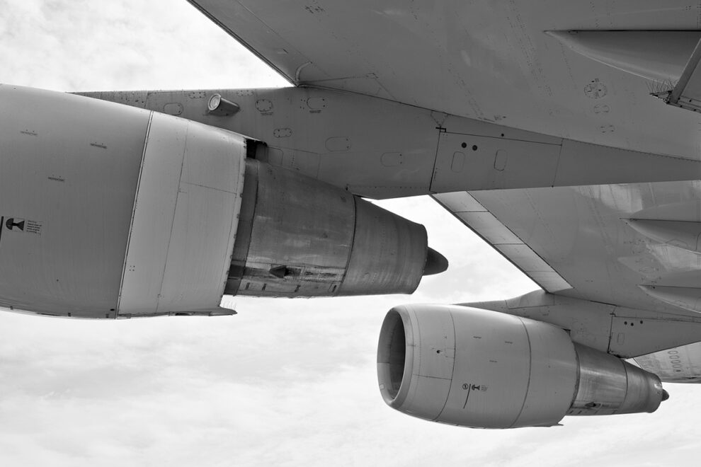 Closeup of aircraft engines in mid-flight.