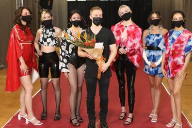 Fashion models pose on a runway