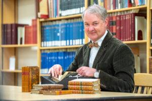 WSU associate dean Trevor Bond leafs through one of the first-edition Jane Austen novels