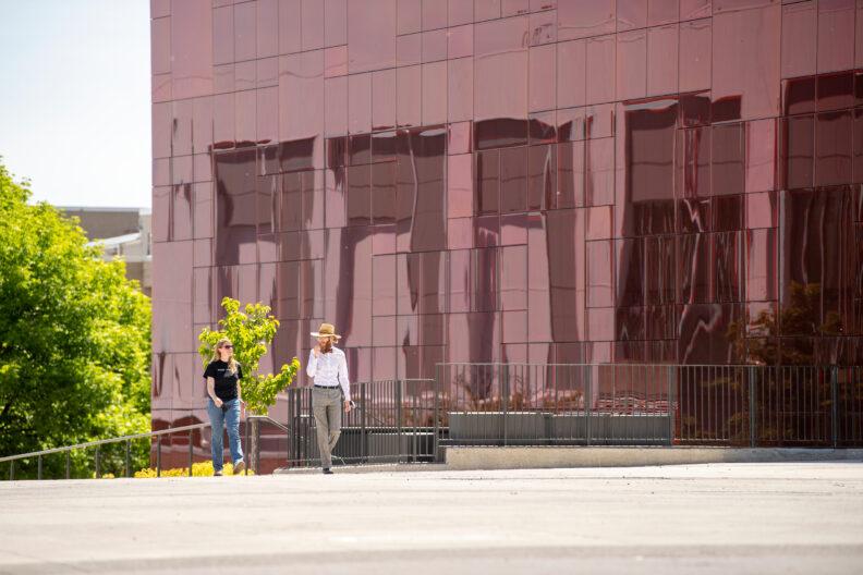 Two people walking on the WSU Pullman campus.