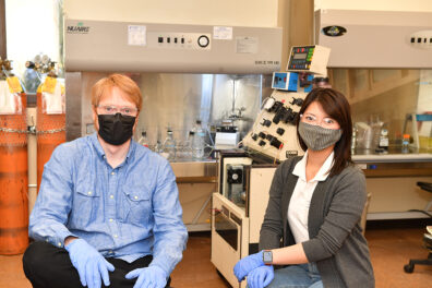 Graduate students Kitana Kaiphanliam and Brenden Fraser-Hevlin pose for a picture.