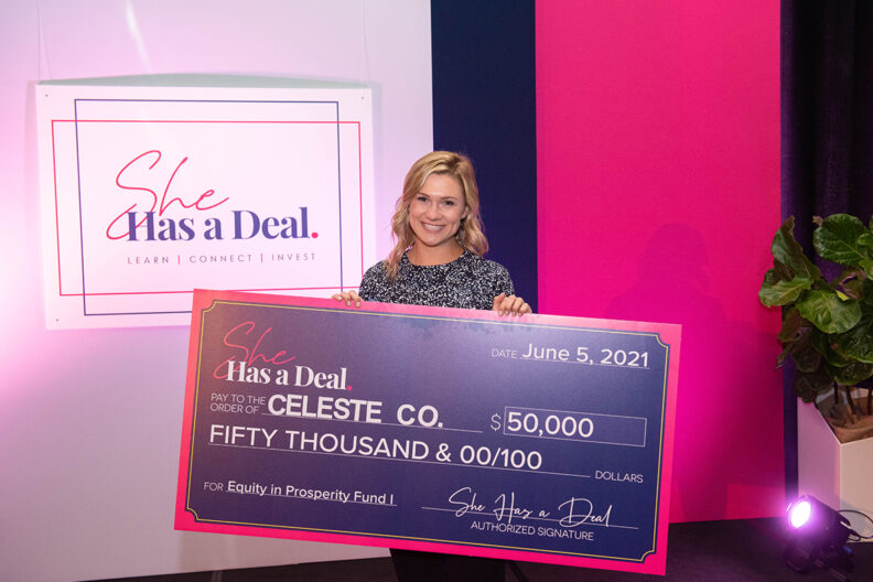 Emma Claire Spring holds a big check she won during a business competition.