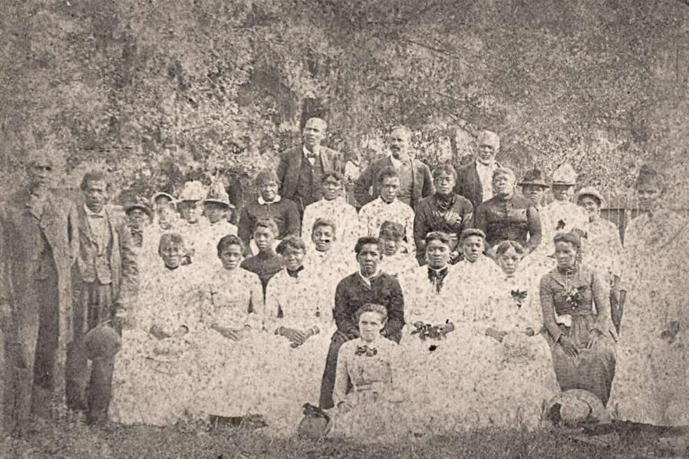 A black and white photo of several men and women at a Juneteenth Celebration in 1880.