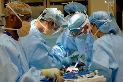 Closeup of a surgical team in an operating room.