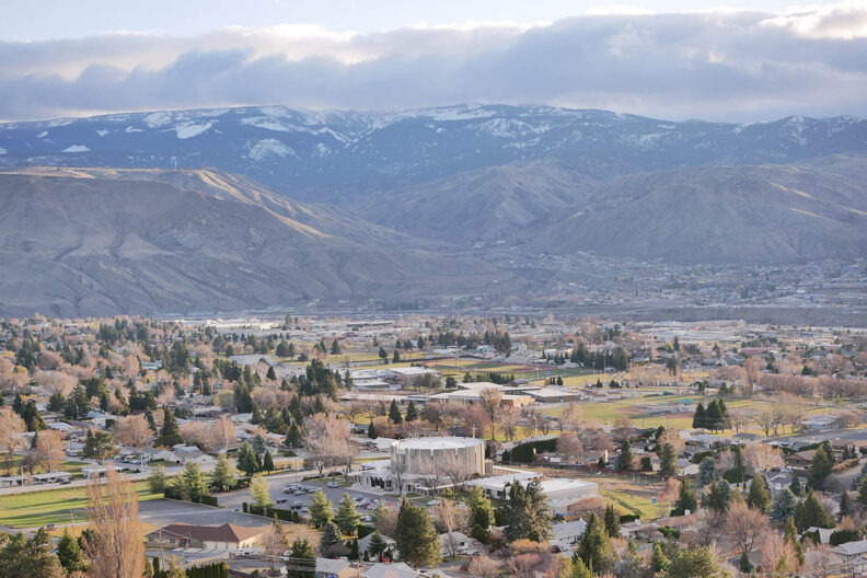 The Washington state town of Wenatchee with mountains in the distance