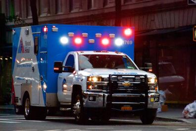 A ambulance parked with its lights flashing.