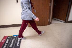 Cougar Health Services employee walking