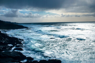 Ocean waves crashing against a rocky coastline.