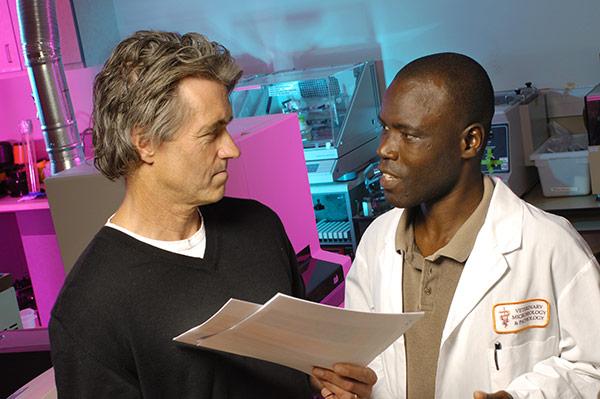 A closeup of a researcher talking to a man