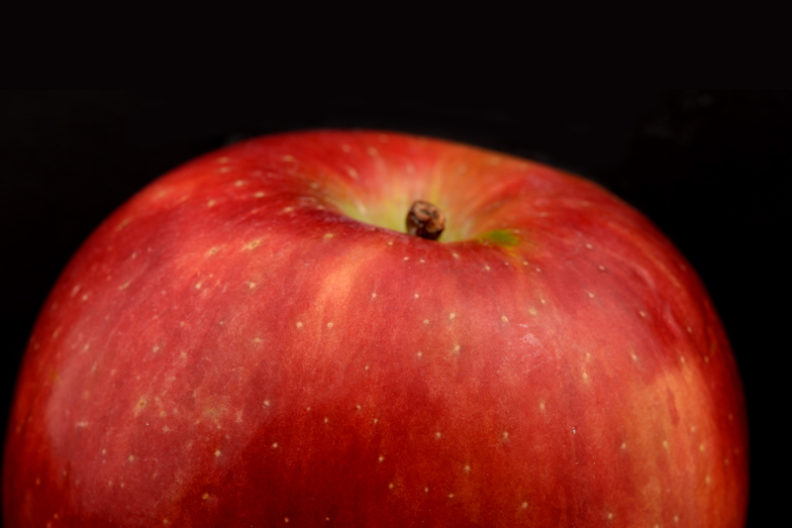 A closeup of the top of an apple