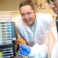 Mike Kessler and student in lab