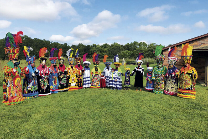 A group photo of Traditional costumed Chinelos dancers