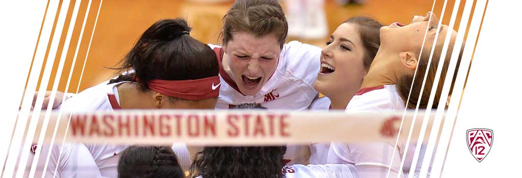 WSU volleyball team celebrating scoring a point