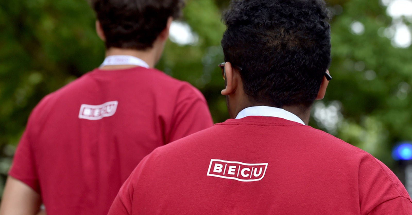 BECU logos on red shirts