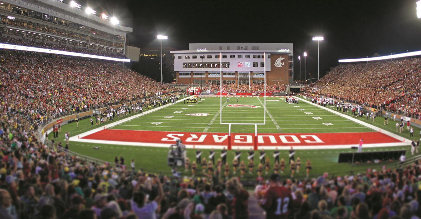 Martin Stadium with a crowd during a football game, night time