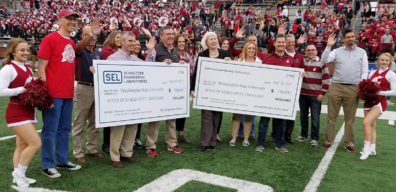 Schweitzer Engineering Laboratories (SEL) present WSU with checks totaling $1.5 million to establish new Edmund O. Schweitzer Chair in Power Apparatus and Systems in the Voiland College.