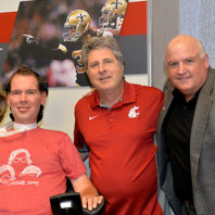Steve Gleason, left, WSU football coach Mike Leach and alumnus Glenn Osterhout at WSU Wednesday.