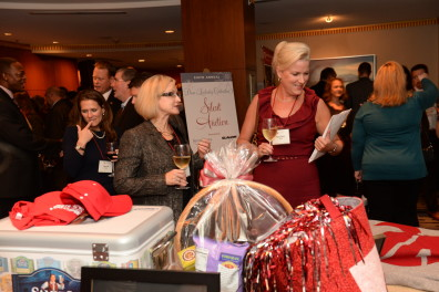 Guests perusing the silent auction tables.