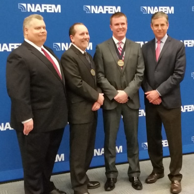 Dennis Reynolds, second from left, during recognition ceremonies at the North American Association of Food Equipment Manufacturers.