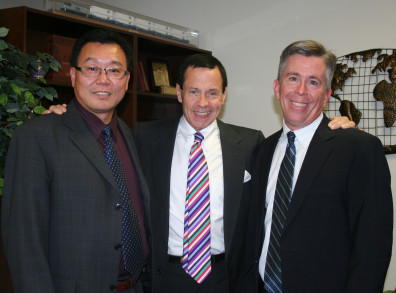 George Jiang, professor of finance, David Darst, David Whidbee, interim dean.
