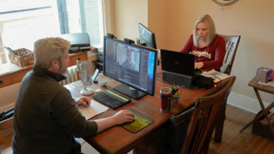 Chris Cooney with his wife, Rebecca simultaneously working on their computers