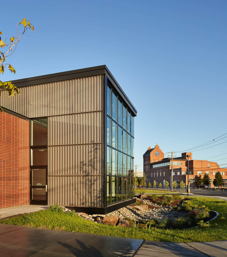 Picture of the northwest end of the teaching health clinic with the Schade Tower in the background