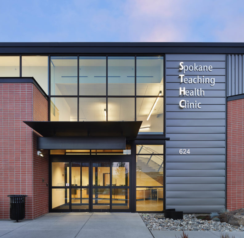 Picture of the front door and building sign of the Spokane Teaching Health Clinic