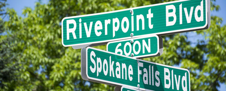street sign at intersection of Riverpoint and Spokane Falls boulevards