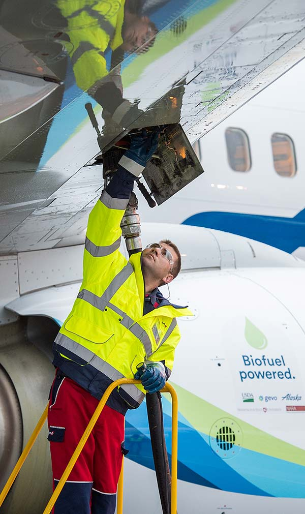 Mechanic fueling airplane