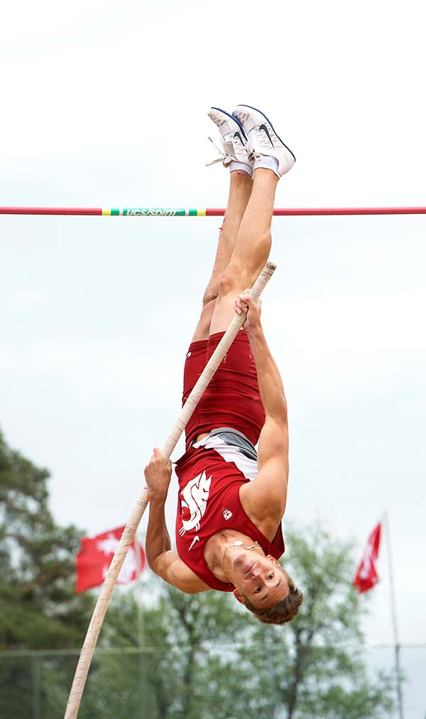 Male athlete competing in pole vault event at Pac12 competition