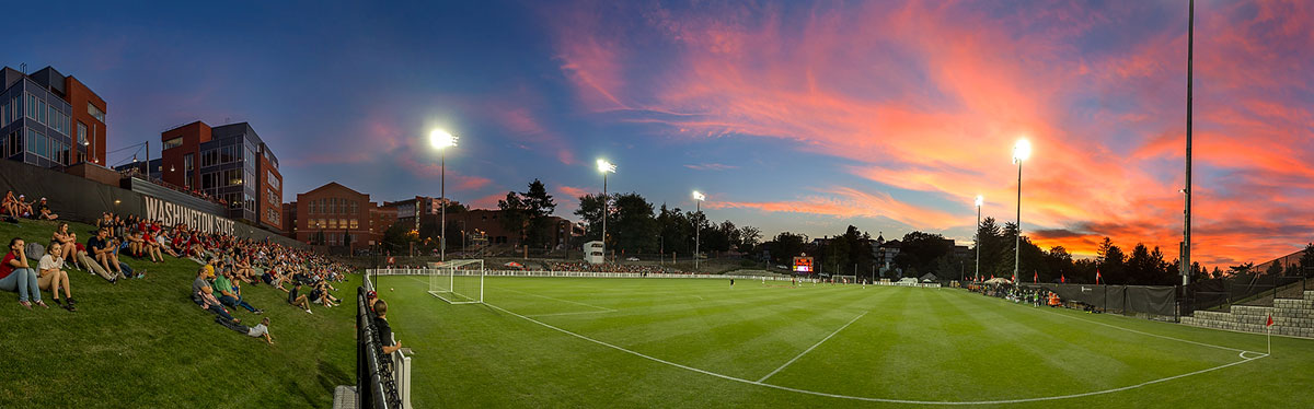 Panoramic view of soccer field at sunset