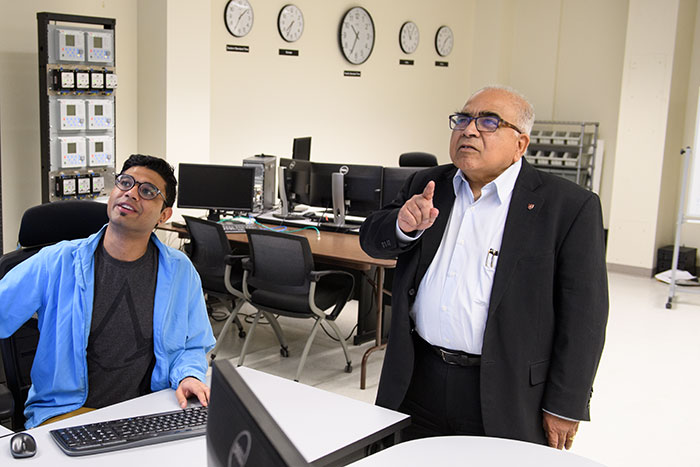 Bose in power grid lab with student