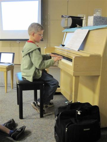PPLS Student performs for Valerie Roth Roubos at Jefferson Elementary