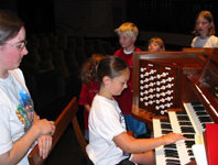 PLSS student at piano