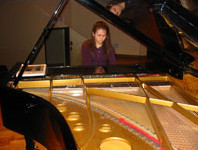 Student practicing piano