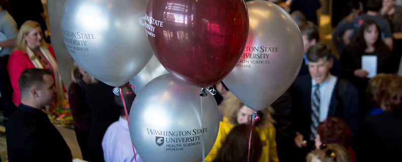 Photo from event with balloons labeled with the campus logo