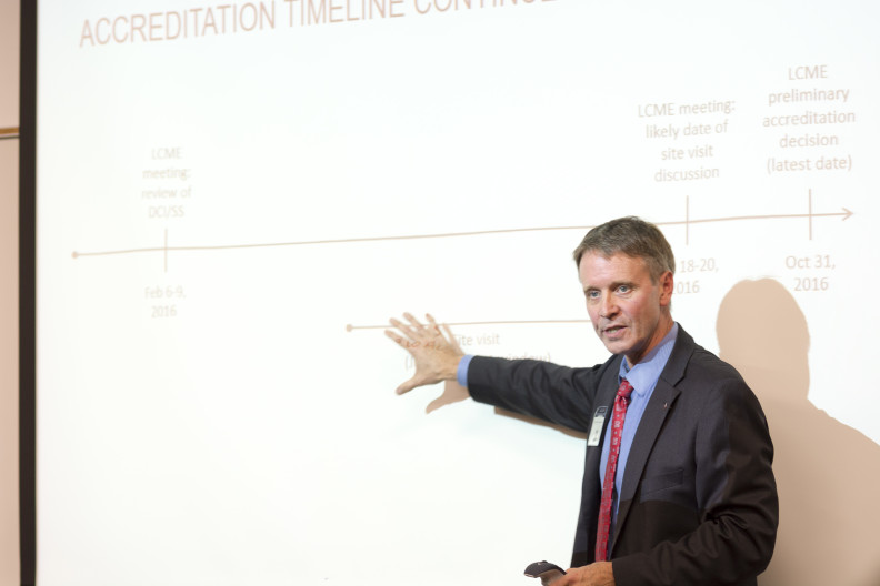 Vice Dean Ken Roberts shows the timeline for WSU's medical school accreditation at a public meeting in Everett in October 2015.